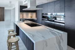 28-a-minimalist-dark-kitchen-with-a-gorgeous-large-white-marble-kitchen-island-for-cooking-and-eating-564x372